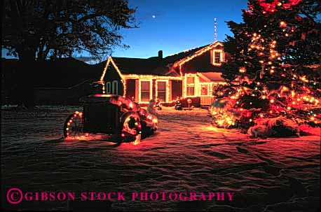 Stock Photo #1724: keywords -  christmas decoration dusk evening holiday home horz house lighting property released snow sunset tree winter