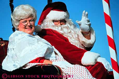 Stock Photo #3530: keywords -  americana cheer christmas claus costume couple holiday horz parade released santa sleigh spirit tradition wave