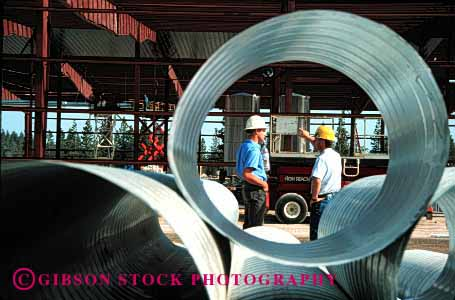 Stock Photo #1746: keywords -  building circle construction duct hardhat horz industry job men model pipe released round steel talk work