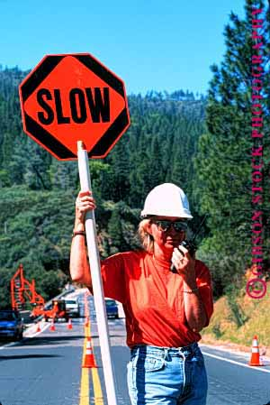 Stock Photo #1751: keywords -  caution communicate construction female flagger hardhat highway job model occupation orange radio released road sign signal slow vert woman work