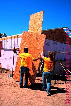 Stock Photo #1775: keywords -  board build charity chip construction cooperate for frame give habitat help home house humanity men new oconto team vert volunteers wisconsin women wood