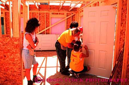 Stock Photo #1776: keywords -  build charity construction cooperate for frame give habitat help home horz house humanity men new oconto team volunteers wisconsin women wood