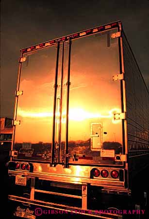 Stock Photo #1825: keywords -  bright clean commerce dawn industry park reflection shiny shipping sunrise sunset transportation truck trucking vert warm