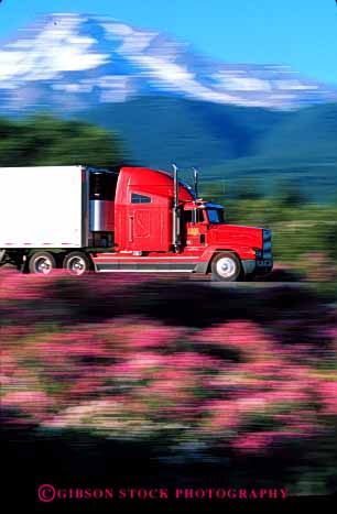 Stock Photo #1832: keywords -  blur commerce dynamic industry motion moving red shipping transportation truck trucking vert
