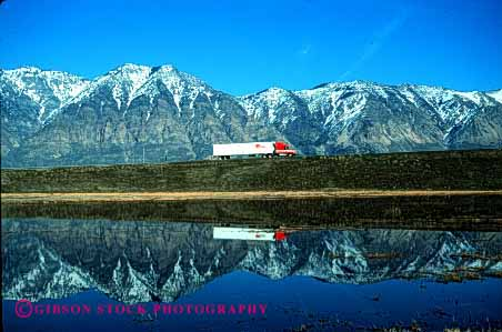 Stock Photo #1839: keywords -  commerce highway highways horz image industry interstate lake landscape like mirror mountains reflecting reflection scenery scenic shipping snow transportation truck trucking trucks utah water winter