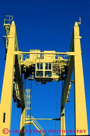 Stock Photo #6177: keywords -  clean commerce container crane equipment green heavy industry lift machine new paint shipping strong transport transportation vert