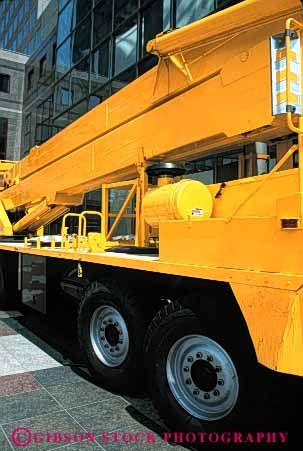 Stock Photo #6178: keywords -  clean crane equipment heavy industry lift machine mobile movable new portable shiny strong truck vert yellow