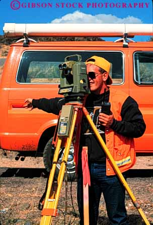 Stock Photo #1859: keywords -  assess career color communication digital distance electronic equipment exact hand into job level look looking looks man measure measuring model occupation orange outdoor people person precise radio record released scope scopes seeing sight signal signaling signals survey surveying surveyor surveyors team vert vision work worker workers working works