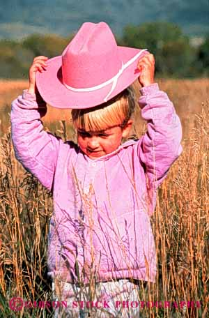 Stock Photo #3340: keywords -  child children cowgirl girl hat outdoors outfit pink released vert west western