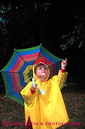 Stock Photo #1883: keywords -  and bright child children coat color colorful colors cute girl girls kid kids material oputdoor outdoor outdoors outside plastic play rain raincoat raining rains released synthetic umbrella umbrellas under underneith vert weather wet yellow