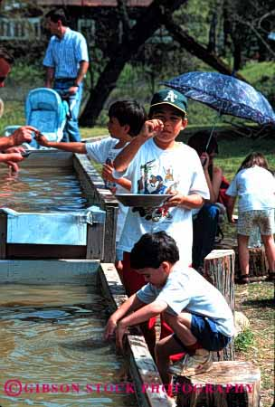 Stock Photo #1886: keywords -  boys california children discovery gold hispanic historic history luck marshall metal mineral pan play precious recreation reenact site together vert water