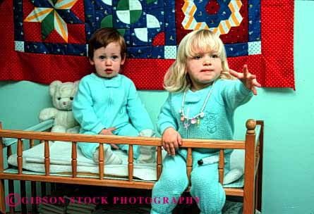 Stock Photo #1890: keywords -  bedroom boy changing children cute girl horz model pair play pose released sleeper table together
