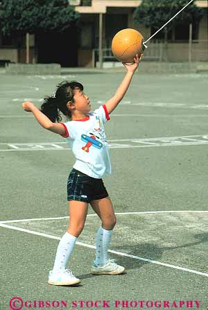 Asian girl playing tetherball on playground Stock Photo 16710