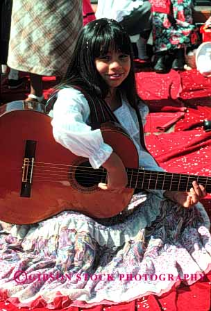 Stock Photo #1903: keywords -  costume dress ethnic float girl guitar hispanic music parade vert