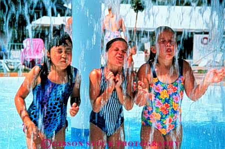 Stock Photo #3346: keywords -  bathing children ethnic girls horz humor park released splash suit summer swim water