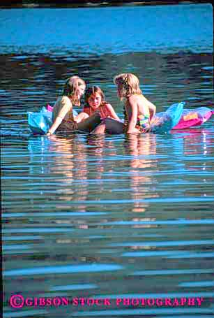 Stock Photo #1913: keywords -  air float girls group lake mat model recreation reflection relax released social summer swim talk together vert water