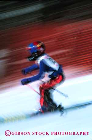 Stock Photo #1921: keywords -  action blur child downhill dynamic fast helmet motion move race ski snow speed sport vert winter