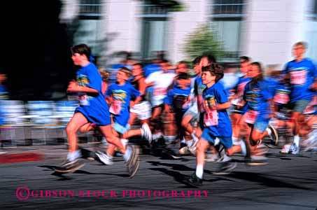 Stock Photo #1923: keywords -  action blue blur child children competition foot group horz legs motion move race run speed sport summer