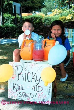 Stock Photo #1932: keywords -  aid boy business child children cute drink ethnic girl hispanic kool lemonade refresh sell stand vert