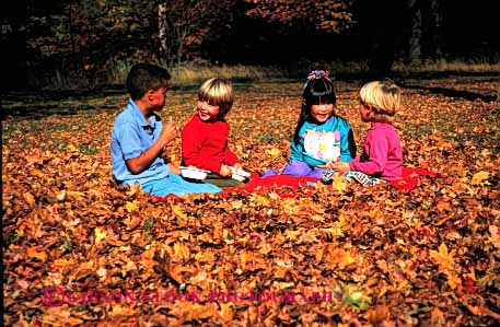 Stock Photo #1938: keywords -  african american asian autumn black boy boys children colorful cooperation eat eating eats ethinc ethnic fall food four friend friends friendship fun gender genders girl girls group happiness happy hispanic horz japanese kid kids leaves mexican minority mixed model outdoor outdoors outside picnic play playing recreation released share shares sharing smile smiles smiling summer together