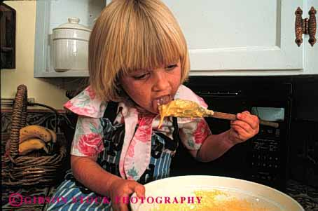 Stock Photo #1939: keywords -  batter child cook cookie cute eat food girl home horz kitchen lick model released taste
