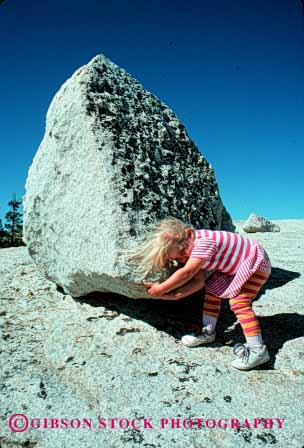 Stock Photo #1944: keywords -  big boulder boulders challenge challenged challenges challenging child children compare compared compares comparing comparison contrast contrasted contrasting contrasts determination differ difference different differing differs difficult effort efforts erratic girl glacier heavy huge impossible job kid kids large lift lifted lifting lifts little persistance pick picks push pushed pushes pushing released resistance rock rocks size sized sizes small summer task tasks tried try trying up vert