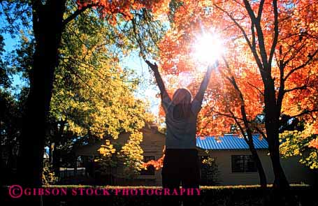 Stock Photo #1958: keywords -  arms autumn bright embrace fall foliage girl horz landscape model nature orange outdoor released scenic silouette sun sunshine