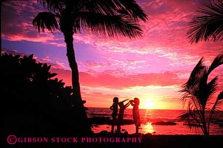 Stock Photo #1961: keywords -  beach bright child children colorful girl group hawaii horz landscape model ocean palm pink released scenic silouette summer sun sunset together tree vacation warm water