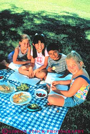 Stock Photo #3359: keywords -  boy child children cooperate ethnic food friend girl group outdoor picnic released summer together vert