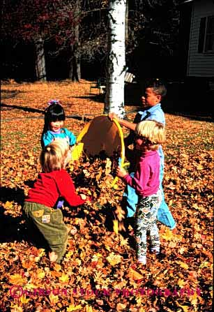 Stock Photo #1979: keywords -  african american asian autumn black boy boys children ethnic fall friend friends friendship fun gender girl girls group groups in japanese kid kids leaves mix model outdoor play playing recreation released share social vert youth