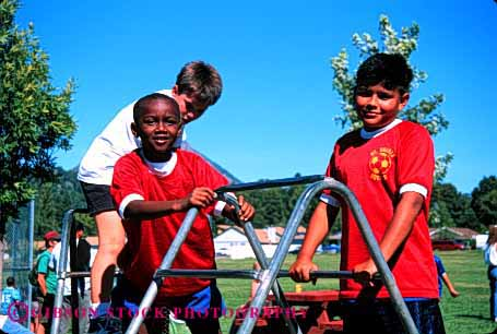 Stock Photo #1998: keywords -  african american black boys climb ethnic friend group hispanic horz mix not outdoor play playground recreation released share social summer three