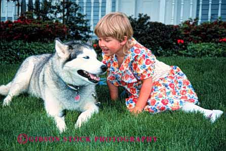 Stock Photo #2012: keywords -  affection animal child dog fur girl happy home horz husky love mammal released talk touch with