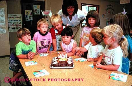 Stock Photo #2018: keywords -  adult birthday boy boys cake cakes celebarte celebartes celebrate celebrating child children daycare development education ethnic gender genders girl girls group groups having horz kid kids learn minority mixed multi parties party play playing plays presch preschool released social teach teacher with