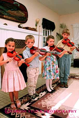 Stock Photo #2022: keywords -  boy child children cute girl group harmony home instrument music playing practice released skill social sound string vert violin violins