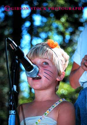 Stock Photo #2024: keywords -  child children concert cute face girl girls into kid kids microphone music musical musician nouth outdoor perform performing released show sing singer singers singing sings skill song sound summer vert vocal voice