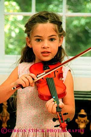 Stock Photo #2025: keywords -  child children girl girls harmon home instrument instruments kid kids lesson lessons musical musician play playing plays practice practices practicing released skill sound string stringed vert violin violins youth
