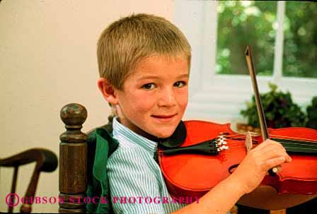 Stock Photo #2027: keywords -  boy boys child children cute home horz instrument instruments kid kids lesson lessons musical musician play playing plays practice practices practicing released sit sitting skill smile sound string stringed violin violins youth