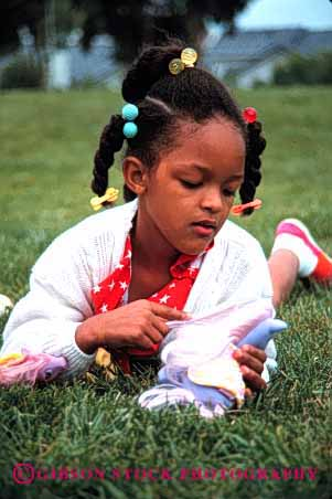 Stock Photo #2047: keywords -  african american black brush child comb doll ethnic game girl hair healthy model outdoor play relax released vert