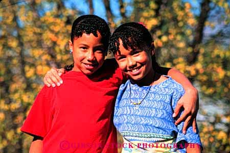 Stock Photo #2051: keywords -  affection afric african american black buddies child children embrace embraced embraces embracing ethnic friend friends friendship girl girls happy healthy horz hug hugging hugs identical kid kids love model outdoor released sibling siblings sisters smile smiles smiling summer together twin twins