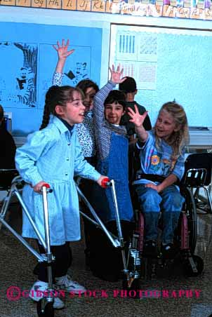 Stock Photo #2075: keywords -  boy child children class classmate disability education elementary friend girl handicap interact learn model needs released school share social special team vert walker wheelchair