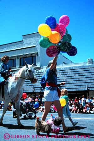 Stock Photo #2101: keywords -  balloon child children fourth horse july mother of parade pets vert walk