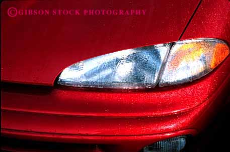 Stock Photo #2124: keywords -  auto automobile car dew drops headlight horz paint polish rain red shiny transportation vehicle water