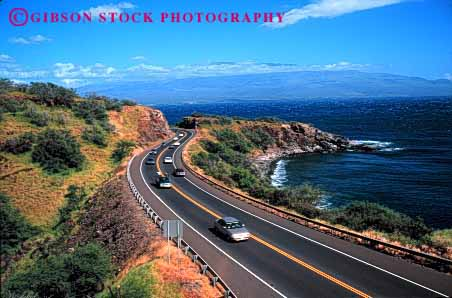 Stock Photo #2176: keywords -  auto car coast convertible drive hawaii highway horz maui moving ocean red road rural scenic shore street transportation vehicle water