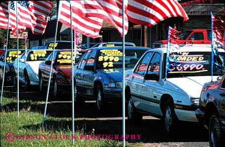 Stock Photo #2185: keywords -  advertise american americana attention auto bright business car center commerce decorate flag getting horz lot sales sell trade transact used