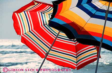Stock Photo #2196: keywords -  abstract beach bright colorful geometric geometry horz pattern radial striped summer sun umbrellas
