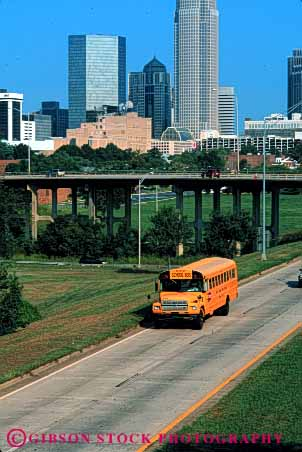 Stock Photo #6142: keywords -  bus buses charlotte city cityscape divided downtown drive highway mass move school students transit transport transportation travel vert