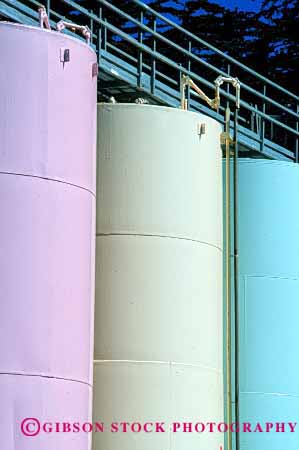 Stock Photo #2209: keywords -  chemical clean colorful cylinder equipment industry liquid manufacturing painted round storage tall tanks vert