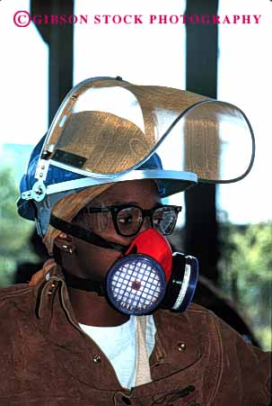 Stock Photo #2243: keywords -  african air american aspirator black breathing burn caution danger face filter fire foundry gear hardhat helmet hot industry injury jacket leather mask metal molten not occupational particle potential protection protective released risk safety scorch screen shield vert ware woman