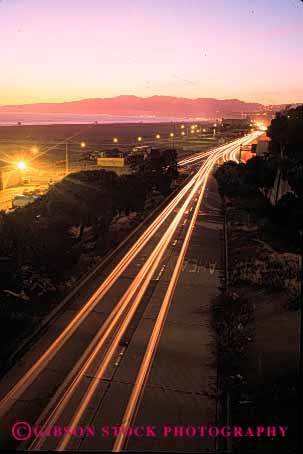 Stock Photo #2270: keywords -  auto beach blur california car city commute drive dusk exposure highway light long monica motion movement one road santa streak street sunset time traffic transportation travel urban vehicle vert