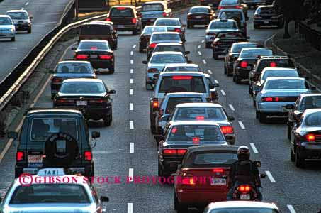 Stock Photo #2284: keywords -  boston bright bumper car caution commute congestion crowd drive dusk group highway horz hour jam massachusetts red road rush slow stop town traffic transportation urban vehicle wait